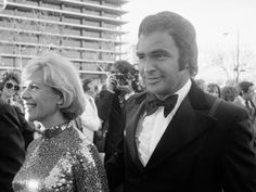 Burt Reynolds, surprisingly, went without his iconic 'stache when he co-hosted the Academy Awards with John Huston, Diana Ross, and David Niven. He's seen here escorting singer Dinah Shore. Eileen Brennan, Oscar Photo, David Niven, Jackie Gleason, John Huston, Burt Reynolds, Thanks For The Memories, Diana Ross, Celebrity Couples