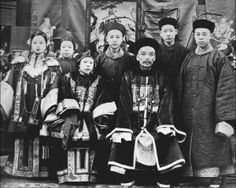 """Chinese public official and family. During the Ming Dynasty, embroidered """"Mandarin Squares"""" began appearing on the robes of court officials (third man from right). These squares indicated the wearer's rank in the government hierarchy."""