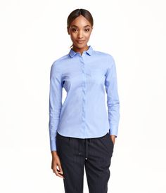 Fitted shirt in a stretch weave with a narrow turn-down collar and concealed buttons down the front.