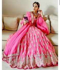 Trending Lehenga Hemlines To Consider For Your Wedding Lehenga Pink Bridal Lehenga, Pink Lehenga, Lehenga Style, Bridal Outfits, Bridal Dresses, Simple Lehenga, Ethenic Wear, Bridal Poses, Bridal Portraits