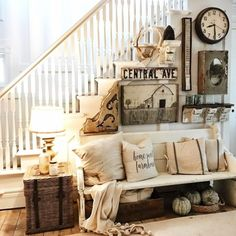 Love this farmhouse foyer idea - unique and eclectic gallery wall with interesting rustic decor items, a wood farmhouse bench that looks upcycled or reclaimed and repurposed to use as a furniture piece.  Great farmhouse entry way decorating!
