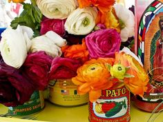 Flower Centerpiece in colorful tins.  Do they still make these tins?