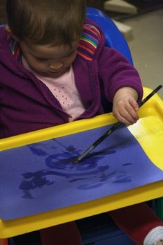 painting with water on construction paper - fine motor art activity for baby
