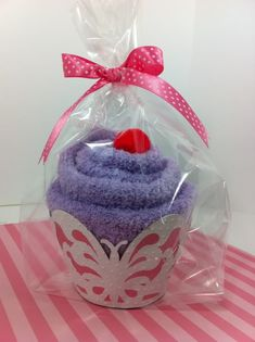 """This """"cupcake"""" is a pair of fuzzy socks! sock folding tutorial http://thegreenbeanscrafterole.blogspot.com/2010/03/recipe-for-fuzzy-sock-cupcakes.html"""