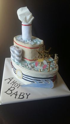 Diaper cake made with 50 diapers, 2 receiving blankets, 3 washcloths and accents.