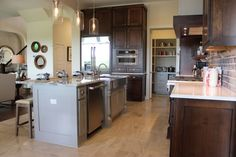 Gray Kitchen Cabinets - Burrows Cabinets - central Texas builder-direct custom cabinets