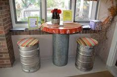 Repurposed beer barrels as furniture and decoration. Repurposed metal beer barrels for homemade furniture. Recycling of a barrel as barstool, table or washbasin in the pub. Bar urinals from recycled beer kegs. Keg Table, Pub Tables, Barrel Bar, Oil Barrel, Pub Sheds, Bar Shed, Barrel Projects, Recycled Furniture, Reclaimed Furniture