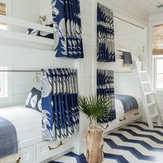 Though black has long been a decorating darling, designers are now enlisting Navy blue for their go-to dramatic hue. When paired with pops of white, red, or yellow it has an especially beachy vibe.