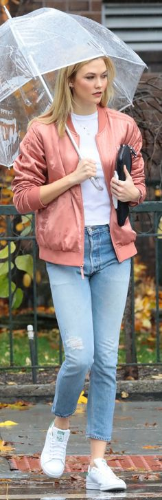 Who made Karlie Kloss' pink bomber jacket, ripped blue jeans, and white sneakers?