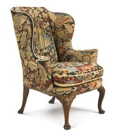 A George II needlework-upholstered walnut wing armchair circa 1730  SOLD. 81,250 USD