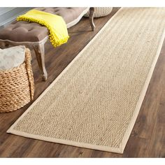 <li>Hand-woven natural fiber rug features a natural background with a beige border</li> <li>Area rug is made from natural seagrass with a 100-percent cotton canvas backing</li> <li>Floor rug features a casual style</li>