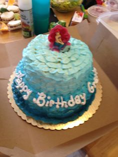 Little Mermaid Ariel Birthday.  2 tier cake using ombre colored buttercream icing in oceanic colors.  Ruffle tip to replicate waves.