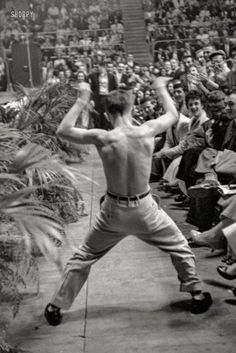 "April 1956. ""Shirtless teenaged boy dancing in the audience at a performance by Bill Haley and the Comets and LaVern Baker at the Sports Arena, Hershey, Pennsylvania."" From photos by Ed Feingersh for the Look magazine article ""The Great Rock 'n' Roll Controversy."""