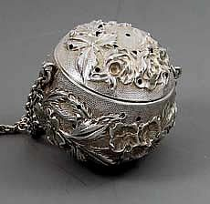 "Jenkins and Jenkins Repousse Sterling Tea Ball  A quality hand chased tea ball by Jenkins and Jenkins. The decoration is of chased flowers and leaves in high relief. Diameter: 1 5/8""    Price: $595.0"