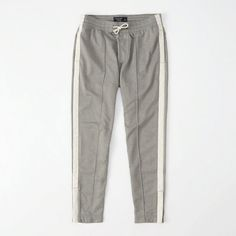 Abercrombie & Fitch Tapered Track Pants ($68) ❤ liked on Polyvore featuring men's fashion, men's clothing, men's activewear, men's activewear pants, grey and track pants