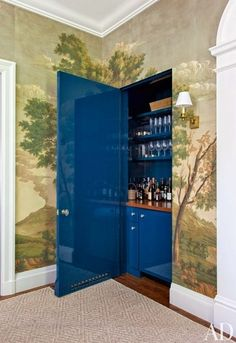 When floor space isn't available for a traditional bar cart, pinners are eager to find wall solutions to store their party essentials. At a California house by Miles Redd, a bar hides within a dining room wall | archdigest.com
