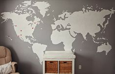 """The Aprecios: Our """"adventure"""" themed nursery... Love the world map with hearts for where their loved ones were born... Maybe add stars for where the baby has traveled."""