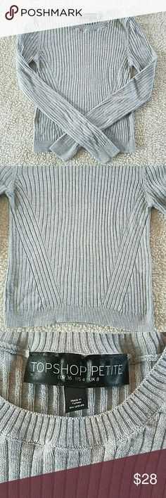 Topshop cropped sweater • Topshop cropped sweater  • Gray ribbed long sleeve sweater/ very stretchy and soft  • 50% viscose, 50% acrylic  • Excellent condition - no holes, stains, or snags  • Smoke free home  • Make an offer! Topshop Tops