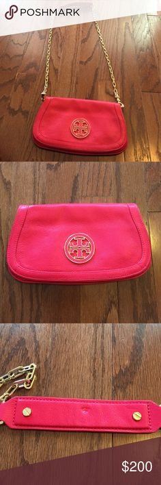 Tory burch Amanda crossbody/ clutch Tory burch Amanda crossbody that can convert into a clutch with removable strap! Carnival red with gold hardware! Brand new, never used!! Small mark on inside of shoulder strap from hanging on purse hook (pictured) unnoticeable when wearing! Tory Burch Bags Crossbody Bags