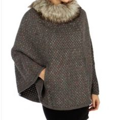 Classic Faux Fur Collar adorns this beautifully woven pull over cape/ poncho. Inset Pockets. Monochrome piping around hemline. $70 One Size fits up to 2X. Charcoal Grey. 95% Acrylic 5%Polyester FREE SHIPPING online or Pick up in store.  | Shop this product here: http://spreesy.com/blacqskirt/69 | Shop all of our products at http://spreesy.com/blacqskirt    | Pinterest selling powered by Spreesy.com