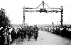 Entering the Ukrainian village Wehrmacht, greeted by the locals. Summer 1941 year.
