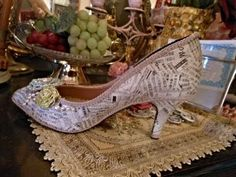 My original fashion shoes design...I am thinking wedding shower center pieces, cover the soles of the shoes too, paint with wedding colors and even a little bling and glitter if you happen to be that kind of gal.