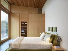 wall of closet, low simple bed by architectural firm Superkül Inc