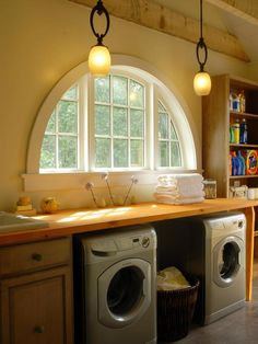 Wood counter w space for hamper btw washer & dryer