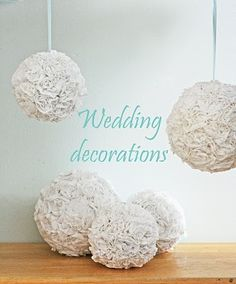 Cool ceiling hangings out of tissue  paper.i think this would work well in the wedding