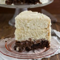 A white cake with a brownie surprise layer! Filled with chocolate sauce and cream cheese frosting, this vintage cake is a showpiece.