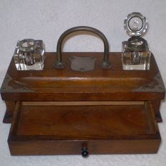 Vintage Antique writing station- Pen and Ink station from 1906-inkwells, pen holder, drawer for paper and pens-wood ink well box. 100.00, via Etsy.