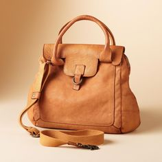 THE KYLIE BAG--This butter-soft leather bag has three inside pockets (one zipped) and a removable webbed strap. Italy.