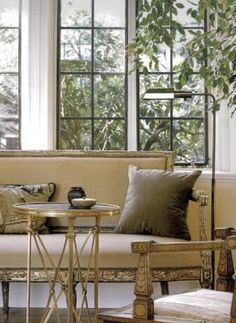 Directorie Table   Global Views; accents make the room.  Combination of Brass, wood, soft texture in the pillow fabric.  Soft color pallet