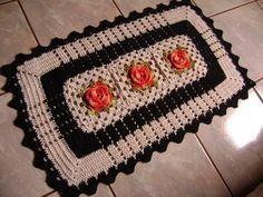 tapetes de barbante de porta com flores laranjas e borda preta
