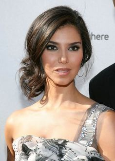 Hair off the face but still natural. Love the loose updo, it looks simple but elegant.