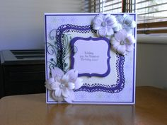 Birthday card using Spellbinders grand decorative labels, shapeability flowers on white and purple card