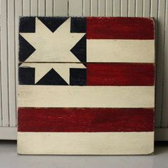 A mini flag barn quilt perfect for the summer holidays. Inspired by the New York Star Flag. Hand painted in Vintage Red, Navy, and Country White....