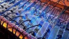"Servers immersed in a liquid cooling solution from Green Revolution Cooling. (Photo: Green Revolution) From the story ""The Immersion Supercomputer: Extreme Efficiency, Needs No Water"" from Data Center Frontier"