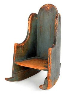NEW ENGLAND PAINTED PINE CHILD'S SETTLEBACK ROCKING CHAIR, 1760, with original blue painted surface and rose head nail construction