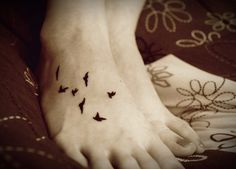 Photo by heather jay on flicker. Love the story behind it {My first tattoo. The 7 birds represent all the members of my family. It also makes me think of the song Black Bird by The Beatles, which I love.}