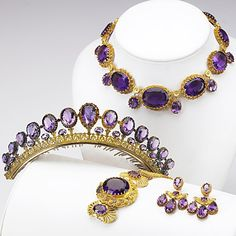 AMETHYST AND GOLD CANNETILLE PARURE Pinkish yellow gold with green gold rosettes and details, the coronet in silver-gilt, ca. 1840. Girondole earrings, coronet with comb, 14'' festoon necklace, 6 1/2'' bracelet. French marks for 18k, marked for Paris. 217 gs. Nothing to do w/Marie Antoinette.