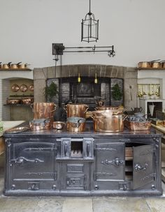 Petworth House Kitchen The Shine on the Cast Iron Stove comes from a Polish Called Black Lead Copper Kitchen, Old Kitchen, Vintage Kitchen, Country Kitchen, Kitchen Decor, Copper Pots, Vintage Appliances, Kitchen Appliances, Kitchen Cooktops