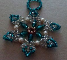 Items similar to Bead and crystal snowflake / wreath ornament. Green and Ivory on Etsy Snowflake Wreath, Crystal Snowflakes, Beaded Ornaments, Bead Weaving, Unique Jewelry, Jewelry Ideas, Beaded Bracelets, Brooch, Wreaths