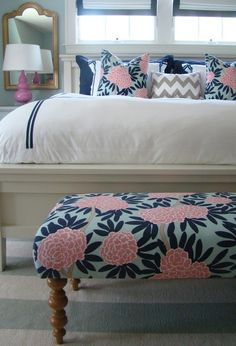 Recover ottoman in light blue ikat, then sew some throw pillows with the same covers.