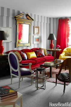 A Moroccan rug serendipitously ties in all the colors of the living room, from the custom sofa by Carlyle to the pillows in Clarence House's Jaguar and an ikat from Inshala Imports. Table lamps, Christopher Spitzmiller.