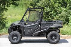 New 2016 Honda Pioneer™ 1000 ATVs For Sale in North Carolina. The outdoors is meant to be explored. The highest hills, the deepest canyons, and the farthest reaches of the forests all lie in wait. And now, we bring you an entirely new vehicle that can get you there. The all-new Pioneer 1000 is the world's preeminent side-by-side, both in the Honda lineup, and the industry. Built around a class-leading 999cc twin-cylinder engine, it can haul up to 1000 pounds and can tow a full ton…