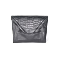City-chic style is all in the details, so streamline your routine with #LRVT's super sleek black 'V' Alligator Clutch. Contrasting black leather and exotic skins, this luxurious piece makes a graphic yet subtle statement. A fine snake chain shoulder strap option makes it easy to go hands free.
