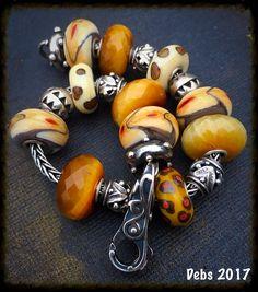 Black squirrels, cats eyes and marble dots by Deborah Taylor