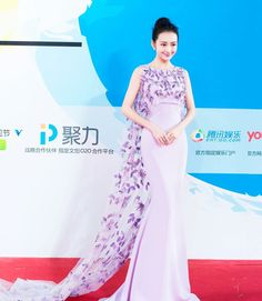Chinese actress, Angel, was gorgeous in GEORGES HOBEIKA for her attendance of The Magnolia Award ceremony at the 2016 Shanghai Film Festival. Angel wore light lavender, column gown overlaid with a bib-top cape embroidered in a purple and pink thistle floral design from GEORGES HOBEIKA's Spring-Summer 2016 Couture collection.