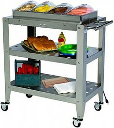 Stainless steel kitchen cart with four warming pans and a 6' electrical cord by Broil King.